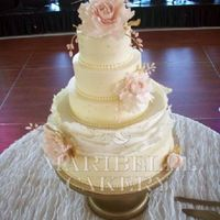 Blush And Gold Accents On A Buttercream Wedding Cake This is a buttercream cake with one layer n fondant large ruffles. https://www.facebook.com/maribellecakerycincinnati