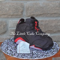 Air Jordan Sneaker Cake  so this cake was tricky! .I'm sure if you could have seen me working on this one, you would see smoke coming out my ears!! The...