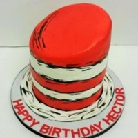 "The Cat In The Hat this is 3 layers of 7"" round cakes. All frosted in Pastry Pride. The red was air brushed."
