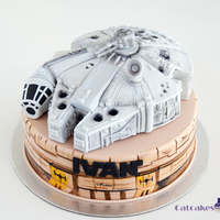 Millenium Falcon Mos Eisley cake with Millenium Falcon. Everything is edible. Millenium Falcon was RKT and fondant made.We really enjoy making this cake,...