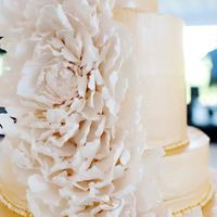 Fantasy Peony Gold buttercream cake, outside wedding in June. This particular day was very hot. I made a lovely peony fantasy flower for the cake and it...