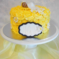 Yellow Roses Baby Shower Cake This cake is iced with butter cream roses and a fondant baby topper.