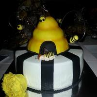 Bumble Bee Baby Shower   This is a white cake with Lemon Curd filling. The Beehive is made of RC and all decorations are made of fondant.