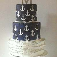 Anchors Away Three tiered wedding cake for a couple that enjoys boating. Wedding was at a Marina. Bottom tier is covered in fondant ruffles, and the...