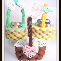 3-D Easter Basket Cookies Stacked oval and round scalloped cookies using colored and chocolate NFSC dough and RI for adhering the layers. Twizzlers candy handles as...