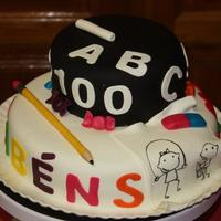 Lesson N. 100 Celebrating the one hundred lesson. Chocolate cake filled with condensed milk covered with sugar paste.