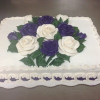 Purple And Ivory Buttecream Roses buttercream roses and overpiped boarders