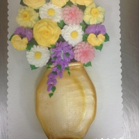Spring Flowers In Buttercream Inspiration Challenge Entry 24 cupcakes iced in buttercream icing. floweres in buttercream. vase air brushed gold.