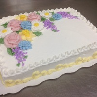 Spring Buttercream Flowers roses, daffodils, daisies, lilacs, and cornflowers done in buttercream