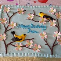 Dogwood Blossoms And Goldfinches This cake was for my mother's 70th birthday. Since 2 of her favorite things are flowers and birds, and her birthday was on the first...
