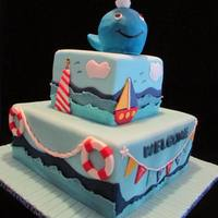 Nautical Baby Shower Shower cake for a baby boy. Baby on whale's spout has sailor's hat and collar. WASC cake with buttercream and blackberry jam...