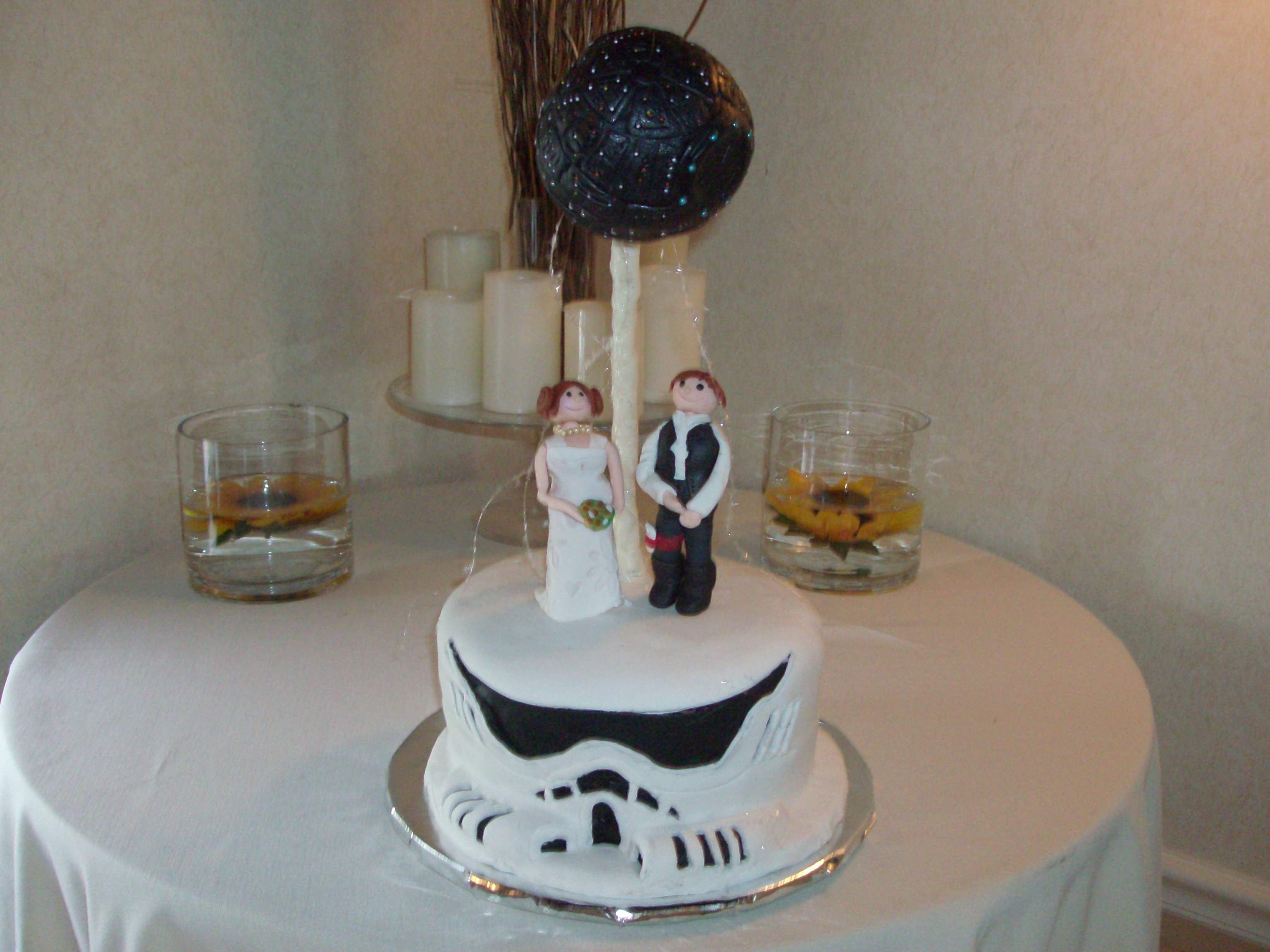 Star Wars Grooms Cake This was a groom cake for a wedding I did this past summer. Storm Trooper for the base, Bride and Groom standing on top with the Death Star...