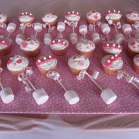 Baby Rattle Cupcakes  Made for a baby shower. Vanilla cake with cream cheese frosting. Fondant and candy pearls for decorations. It's a girl curling ribbon...