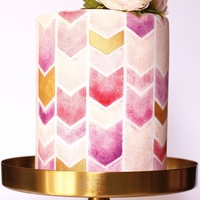 Springtime This spring themed bridal shower cake incorporated a beautiful palette of peach, pinks, purples and gold, stenciled onto an extra tall cake...
