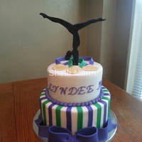 Gymnast Cake This is a butter cream cake with fondant accents. The silhouette is gum paste.