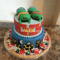 Teenage Mutant Ninja Turtle Cake This is buttercream with fondant accents.