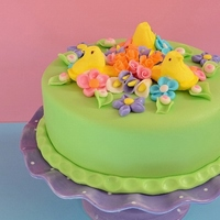 Peeps Easter Cake The classic marshmallow treats are featured atop this Meyer lemon cake frosted in raspberry buttercream. Cloaked in a spring green fondant...