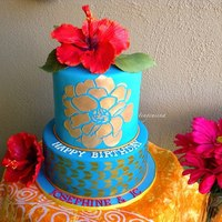 "Hibiscus Hawaiian Theme Cake for my friend who turned 50 y/o but refused to declare it, and co-celebrating with her son. So used ""gold"" to add a hint. Used..."