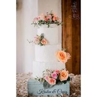 Country Chic Wedding Cake Fresh flowers, rustic decoration. One photo is the professional shot and the other is the not so professional shot that I took.