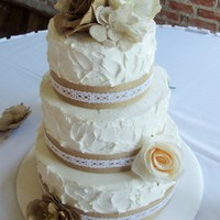 Burlap & Lace Weddingcake Bride provided inspiration photo for this rustic theme wedding cake.