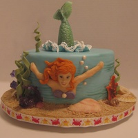 Mermaid Cake For A Little Red Haired Girl Who Loves Mermaids. I told the grandmother that I cannot make an Ariel, but will make a red haired mermaid. The cake is lemon with a fresh raspberry filling,...