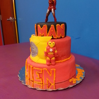 Iron Man Cake This was an Iron Man cake made for a little boy's bday party. My favorite part is the Iron Man figurine i made from Fondant. His...