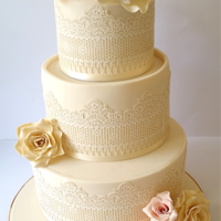 Ivory Wedding Cake Ivory wedding cake with edible lace and pink, off-white and gold rose details