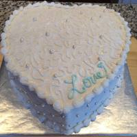 Love Anniversary Cake Heart shaped anniversary cake with fondant pearls