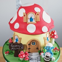 Smurf House Cake  Chocolate and strawberry flavored cake layers filled with dark chocolate mousse and strawberry flavored swiss meringue buttercream (smbc)....