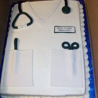 Doctor Coat Buttercream icing with fondant accents. Quick cake for a friend. Thanks for looking