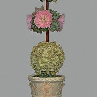 Topiary Italian Wedding Cake Many succulent and roses for this wedding cake.