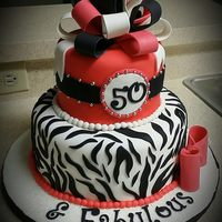 50 & Fabulous Inspired on an existing design. Completely edible. Fondant bow and sugar beads.