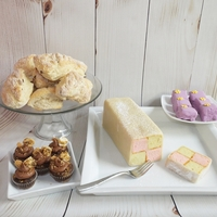 Tea Party Treats  A client wanted to host an authentic tea party, so we did small orange and cranberry scones, mini cupcakes, petit fours and an authentic...