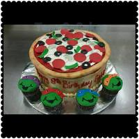 Pizza Anyone Pizza cake with ninja turtle cupcakes to go with it!