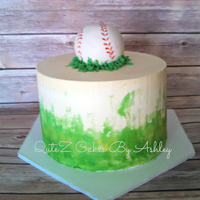 Baseball I used shades of green buttercream to create a water colored grass effect on the cake. The baseball is a large cake ball covered in fondant...