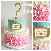 Baby Shower Reveal Cake   Pink and blue ombre of ruffles and polka dots