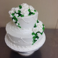 "St. Patrick""s Day Wedding Cake buttercream roses and shamrocks with beveled icing boarders overpiped in lattice and dots."