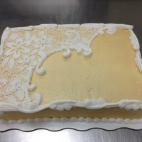 Gilded Lace cake iced in buttercream and airbrushed gold. when dry, the lace was stenciled,then overpiped in buttercream.