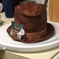Indiana Jones Hat Cake Chocolate WASC with chocolate chip pudding filling. Covered in fondant and airbrushed for details.