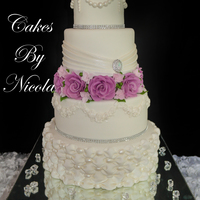 Vintage Wedding Cake With tufted billow, pleats and lace pieces.