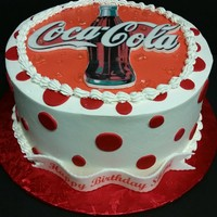 "Have A Coke And A Smile! 10"" round cake covered in Pastry Pride. Edible image mounted on a gumpaste plaque. Piping gel for water droplets"