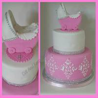 "Baby Glam ""Baby Glam"" themed baby shower cake. The baby carriage is handmade."
