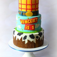 "Toy Story Theme Cake   This is a 10-8-6"" cake tiers for my nephew's birthday... I used marshmallow fondant to cover each tier."