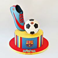 Barcelona Soccer Cake Chocolate mud cake ,chocolate ganache ,fondant stripes.Soccer boot was made with gum paste.