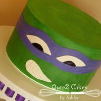 Donatello This cake is made with shades of green buttercream and decorated with MMF mask, eyes and mouth.