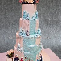 Frozen Themed Wedding Cake This is a plain front wedding cake with hidden back depicting the waterfall from the film Frozen - PJ x