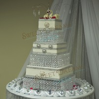 Crystal Wedding Cake Hello this isthe wedding cake i made . I used crystal cake stands that were made by using acrylic sheets and beads. If interested how to...
