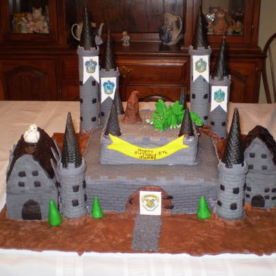 Hogwarts Cake For My Grandson Birthday Buildings Are Rice Treat Covered In Fondant Everything Was Edible Signs Were Made From Edible Ink He...