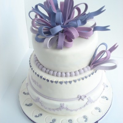First Communion Cake In White And Purple With Hearts