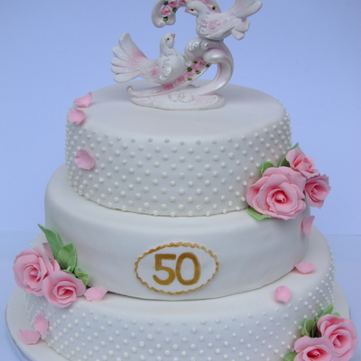 White Wedding Cake With Pink Roses